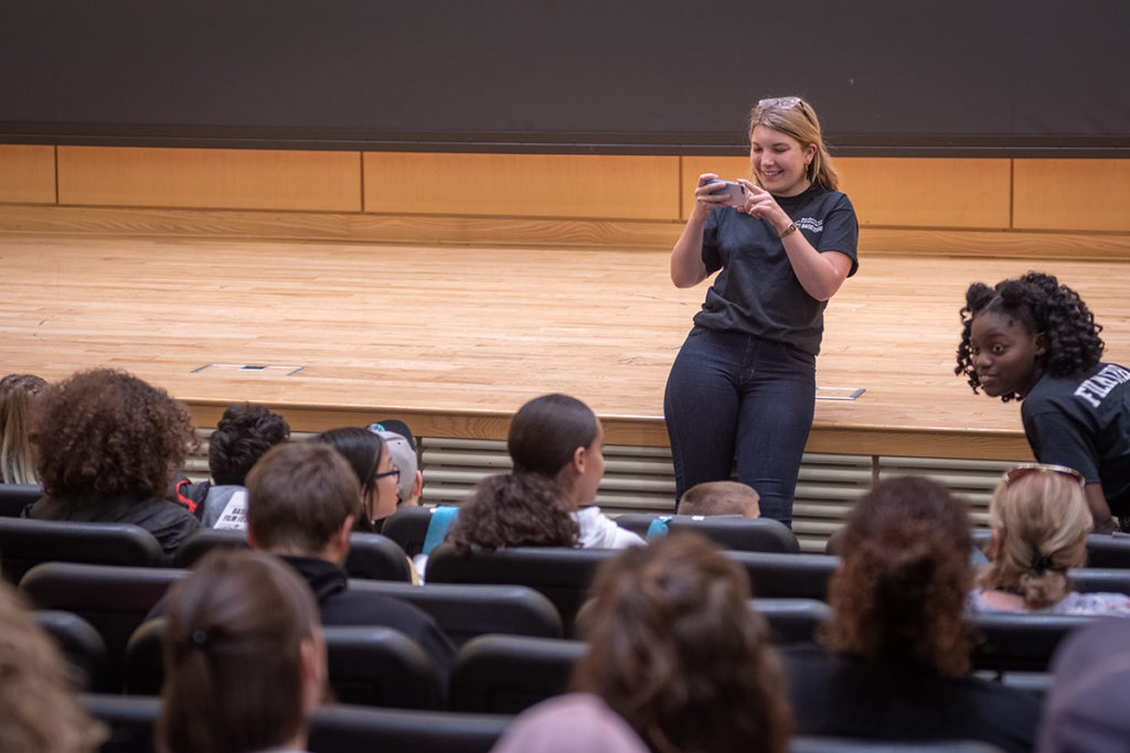 Gillian Rude snaps a photo of the audience.