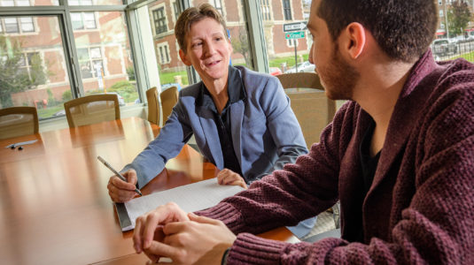 Jennifer Plante works with a Clark University student.