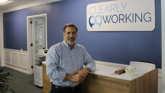 Robert DelMastro at front desk of Clearly Coworking