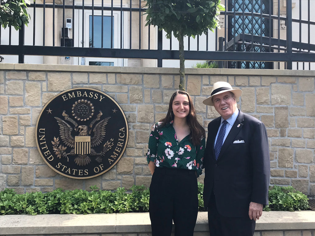 Juliet Michaelsen and U.S. Ambassador J. Randoloph Evans outside the U.S. embassy in Luxembourg.