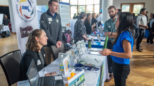 Clark student talks to employers at Career Fair.