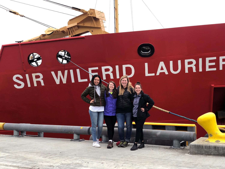 Four Clarkies standy the Sir Wilfrid Laurier.
