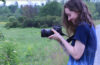 Julianna Lugg with her camera during her tour of New England's six smallest communities