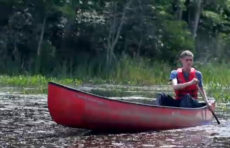 Kasyan Green '21 on a canoe maps Worcester's green spaces.