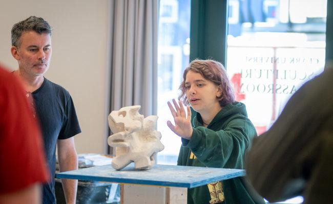 Professor and students work in new sculpture studio