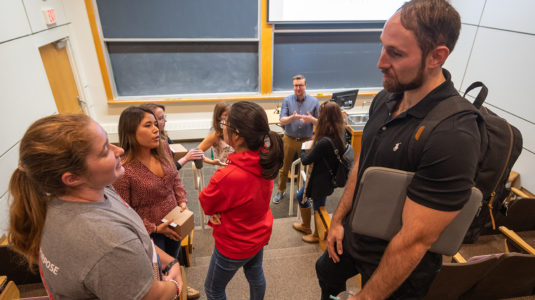 "Noah Schwaegerle '17, M.S. '18, and Emilie Ogisu'17, M.S. '18, chat with Clark students before speaking at Professor Don Spratt's class ""LEEPing into a Science Career."""