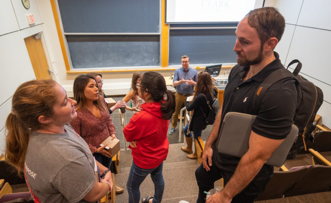 """Noah Schwaegerle '17, M.S. '18, and Emilie Ogisu'17, M.S. '18, chat with Clark students before speaking at Professor Don Spratt's class """"LEEPing into a Science Career."""""""