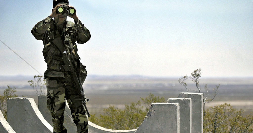 Border security agent with binoculars