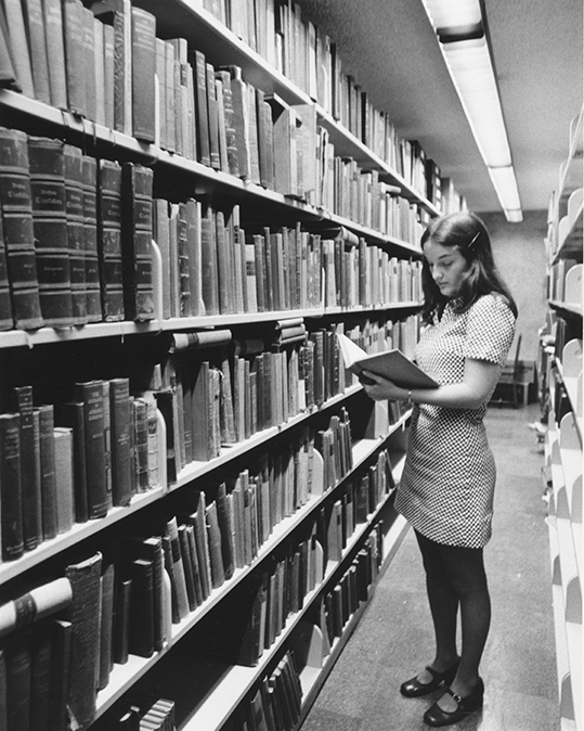 A student in stacks of the newly opened Goddard Library.