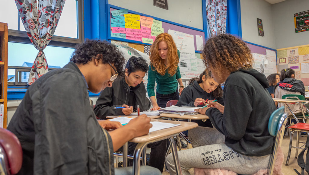 University Park Campus School students work with a teacher in the classroom