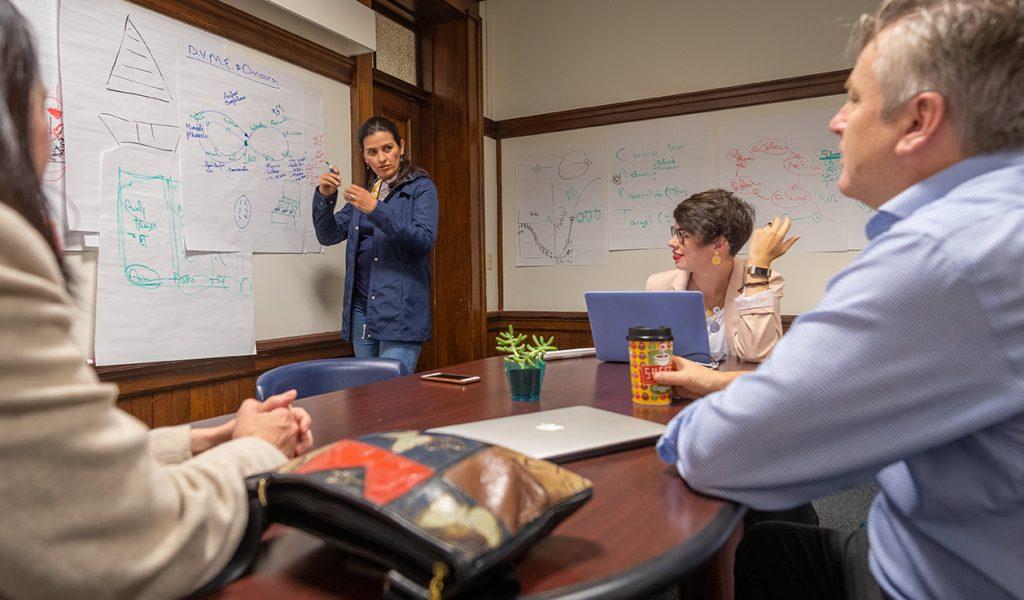 John Dobson works with students in his entrepreneurship workshop at Clark University