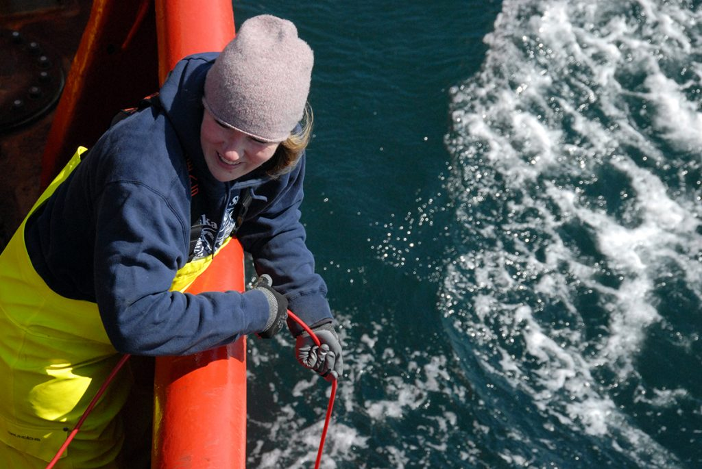 3)Karen Frey deploys instruments into the Bering Sea that measure the transmittance of light through seawater onboard the Canadian Coast Guard Ship Sir Wilfrid Laurier in July 2019