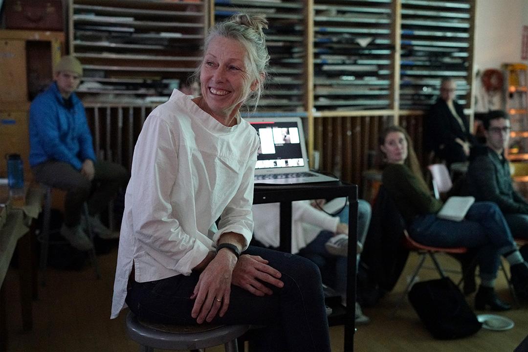 Cheryle St. Onge '83 visits with Clark students in Professor Toby Sisson's studio art class.
