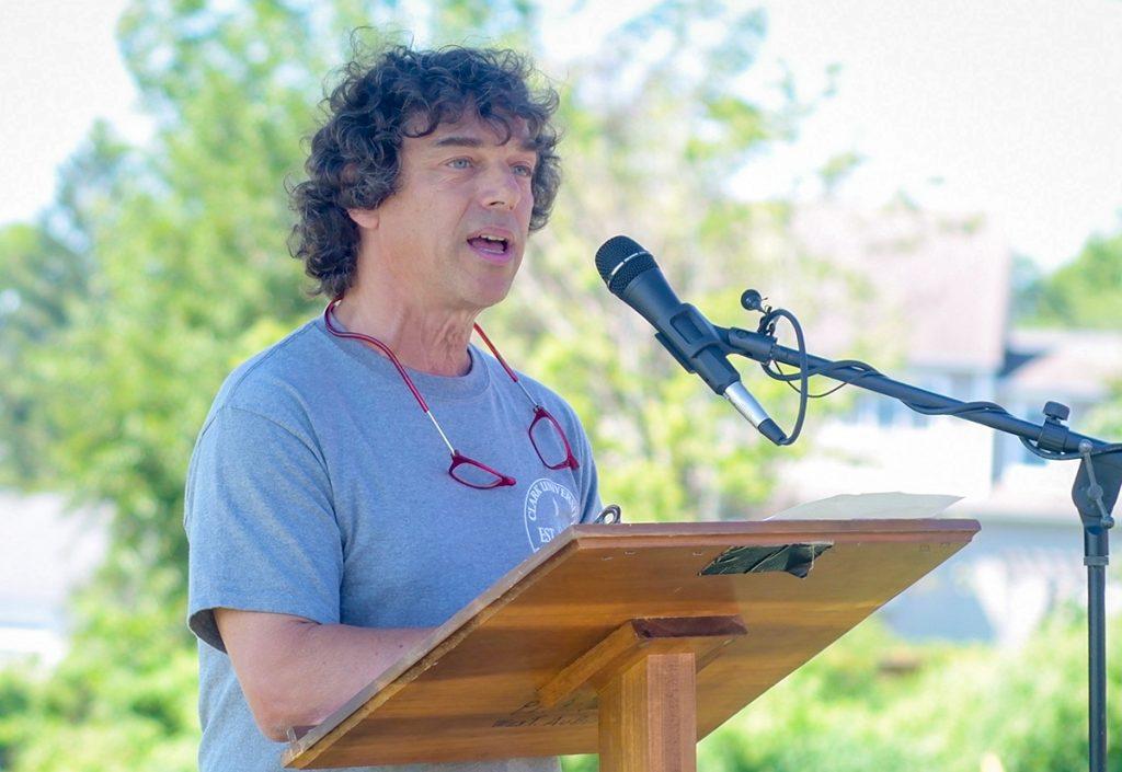 Chuck Agosta speaking at podium