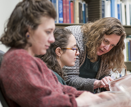 Professor Meredith Neuman works with students