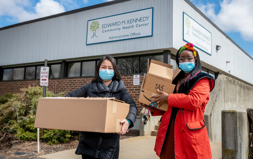 Yingying Chen, M.S. '11, and Bernadine Mavhungu '14 bring donations to the Kennedy Health Center