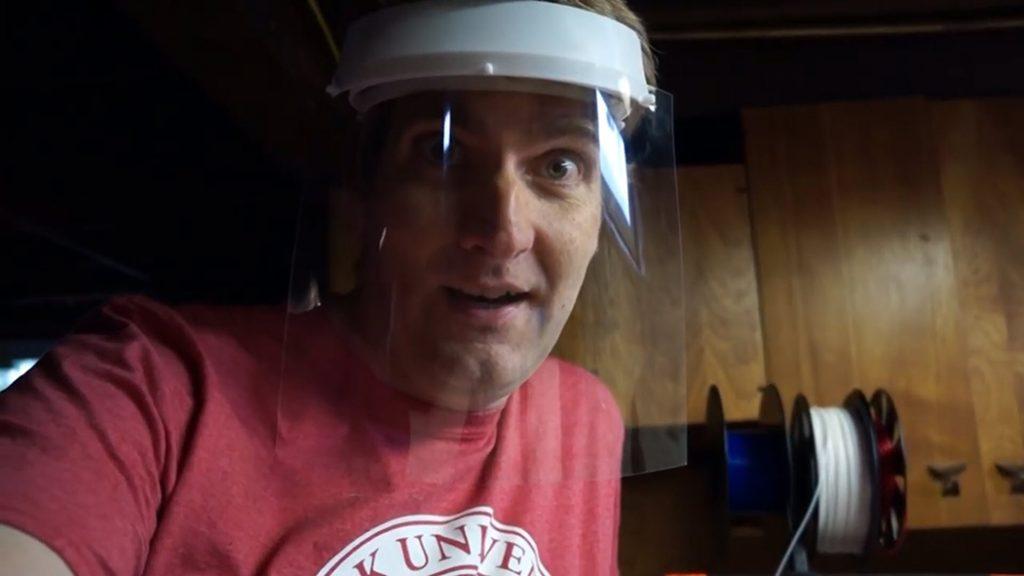 Nathan Ahlgren wears a face mask he just 3D-printed.