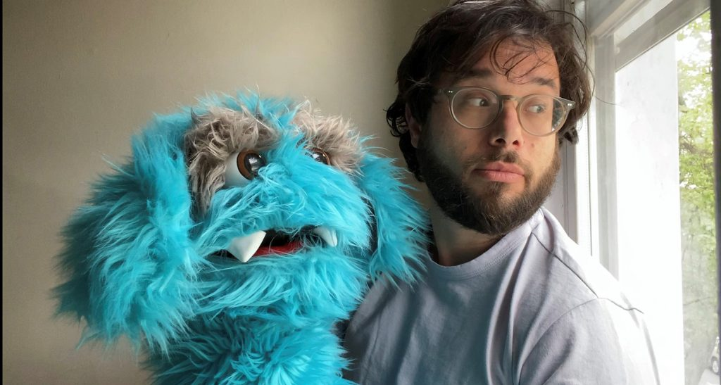 Avi Steinhardt '05 and his monster puppet, Louie