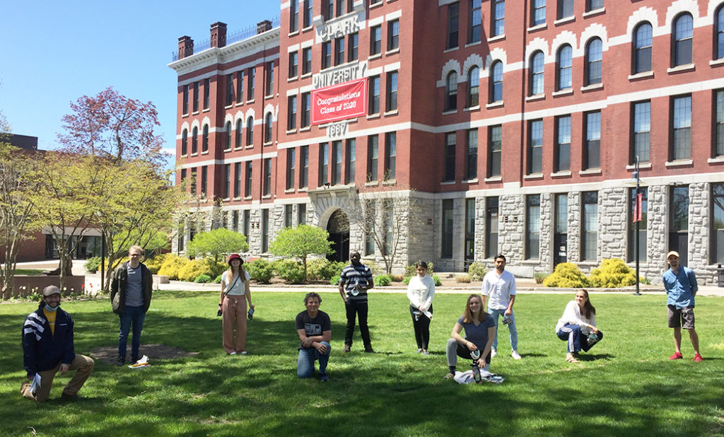 Clark Labs student researchers socially distance on the green