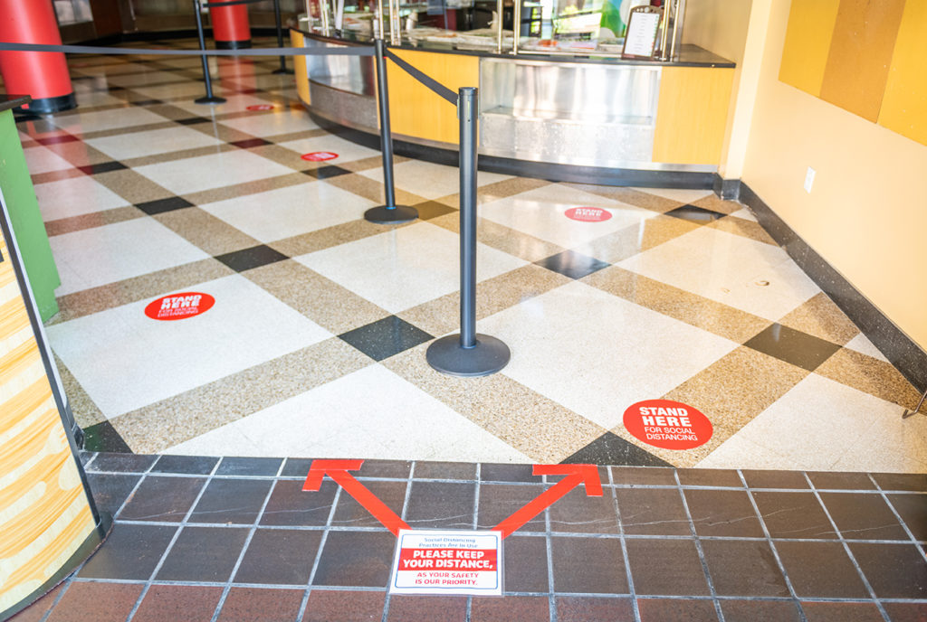 Clark University dining hall directional signs on floor