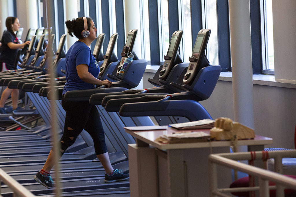 A student runs on the treadmill at the Clark University Bickman Fitness Center