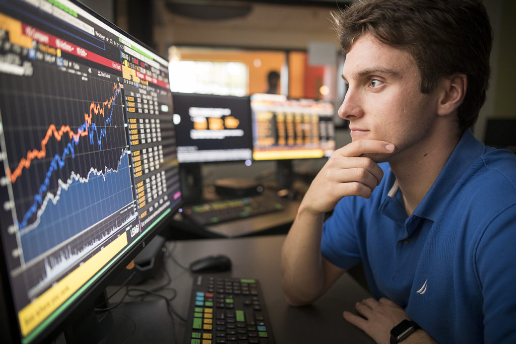 Clark master of finance student at Bloomberg terminal