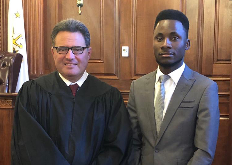 R.I. Superior Court Associate Justice Brian Stern with Emanuel Sapalo '21