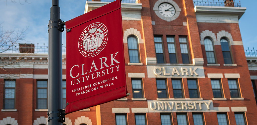 Jonas Clark Hall with Clark University banner in foreground
