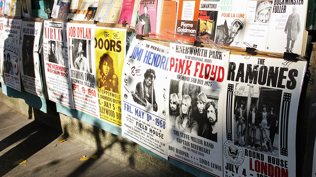 Row of concert posters on wall