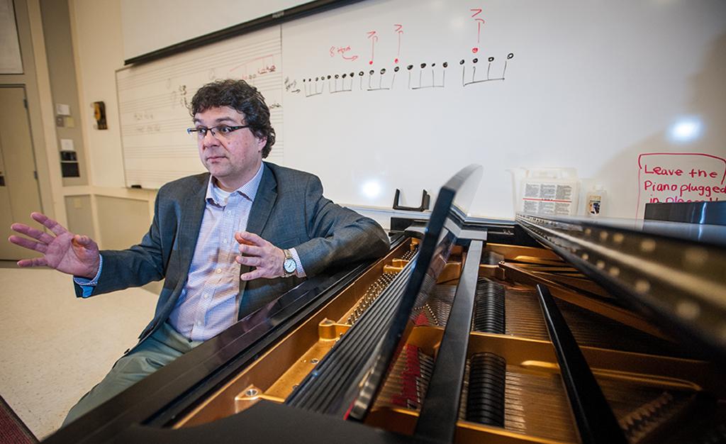 Professor Ben Korstvedt sits at the piano