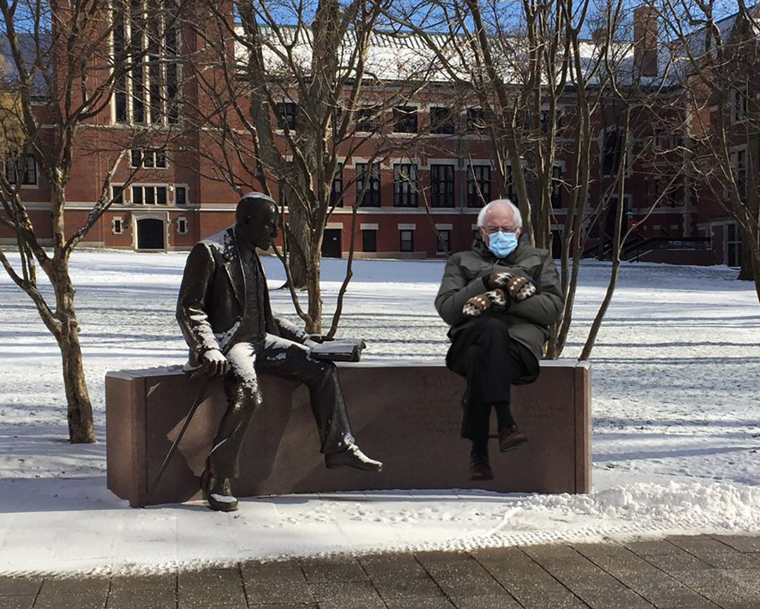 meme of Bernie Sanders sitting next to freud statue at Clark