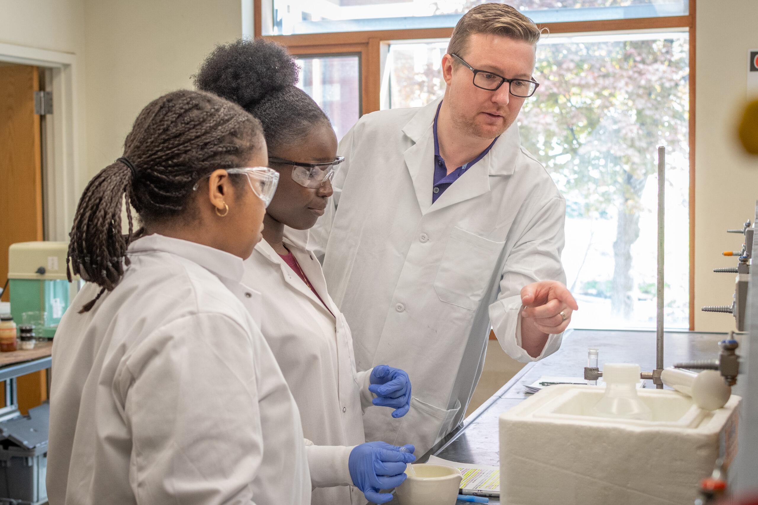 Don spratt with high school students in lab