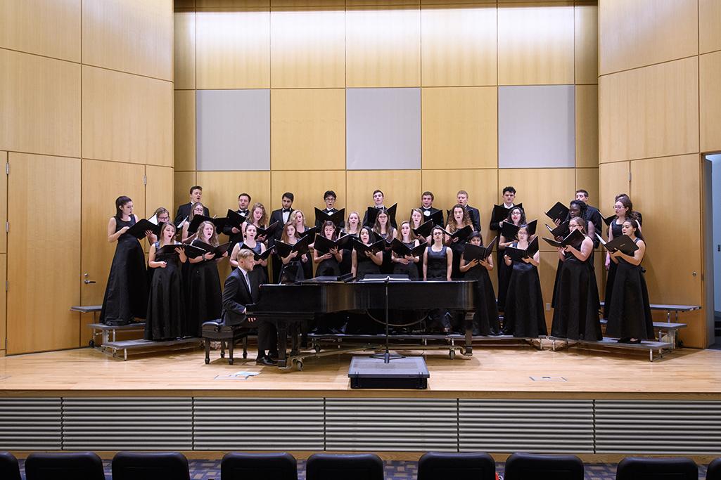 Clark University Concert Choir rehearses in Razzo Hall in 2017