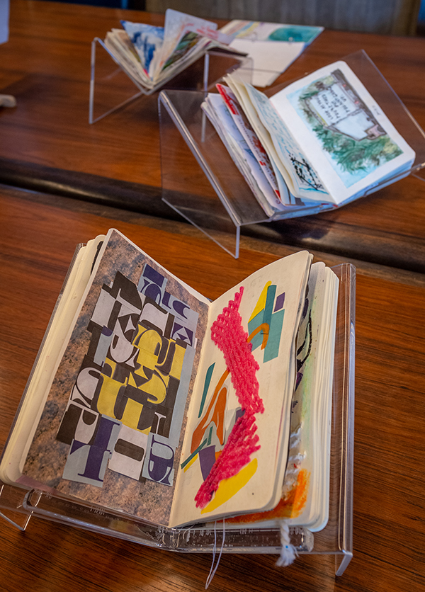 Sketchbooks by Clark University students on display in the Goddard Library Rare Book Room