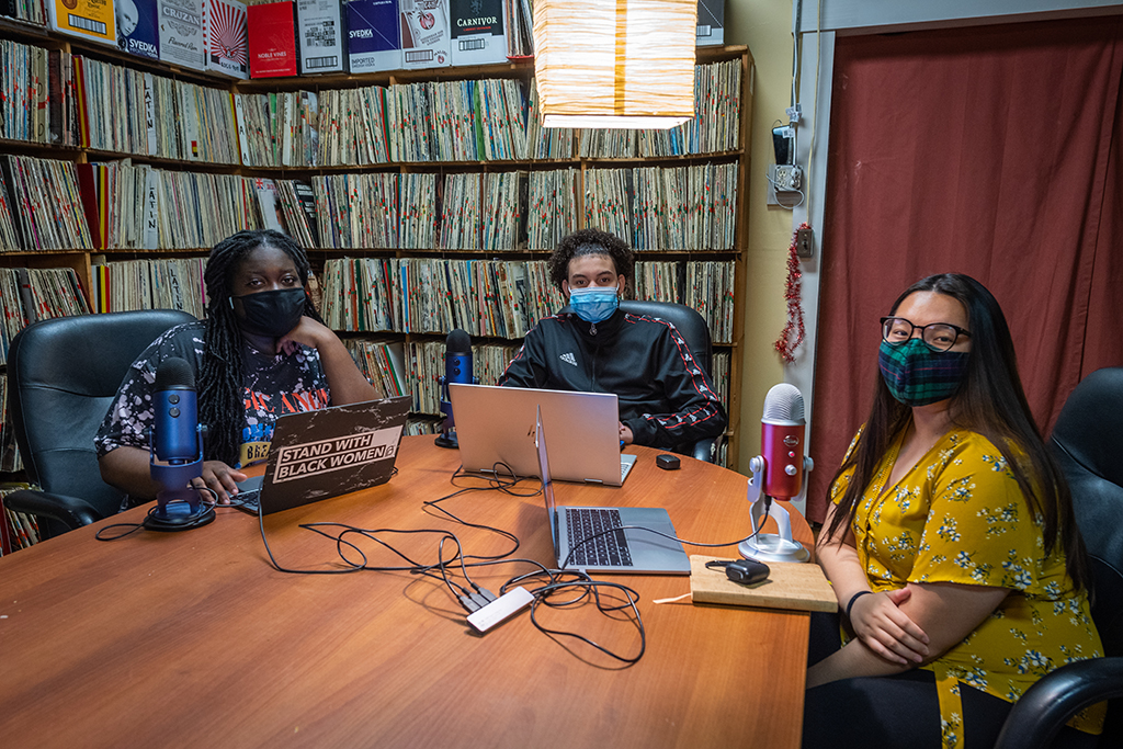 """Hiatt Youth Fellows Yaa Brefo, Debrin Adon, and Jennifer Ha, seniors at University Park Campus School, record an episode of their """"508Discussions"""" podcast at WCUW."""
