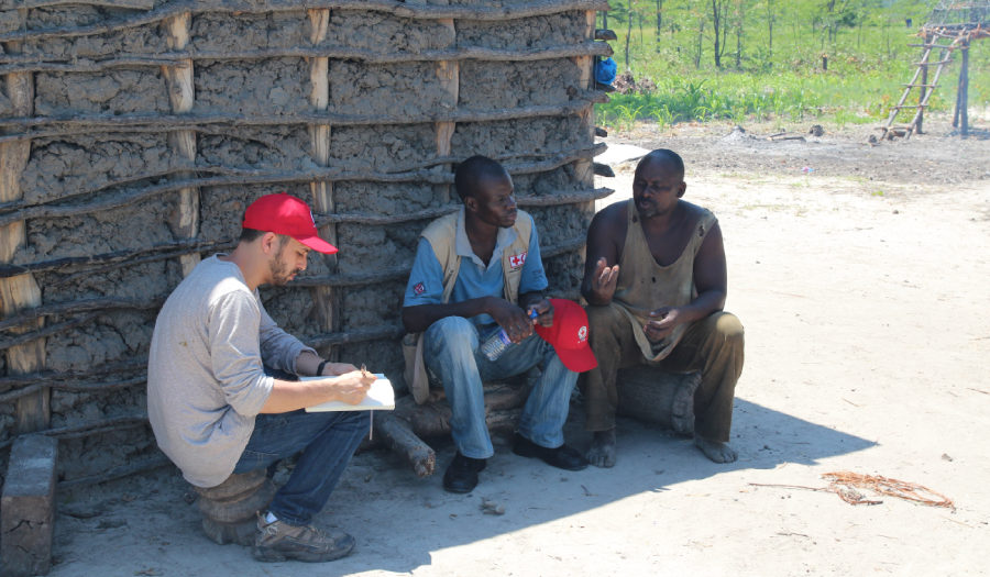graduate student speaking with villagers