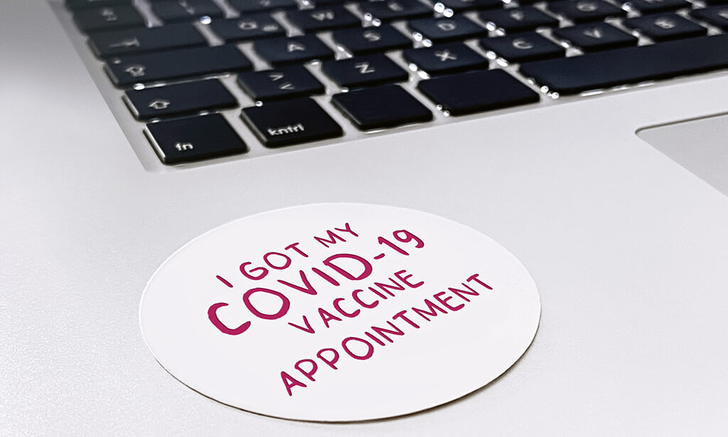 """Sticker on laptop saying """"I got my COVID-19 vaccine appointment"""""""