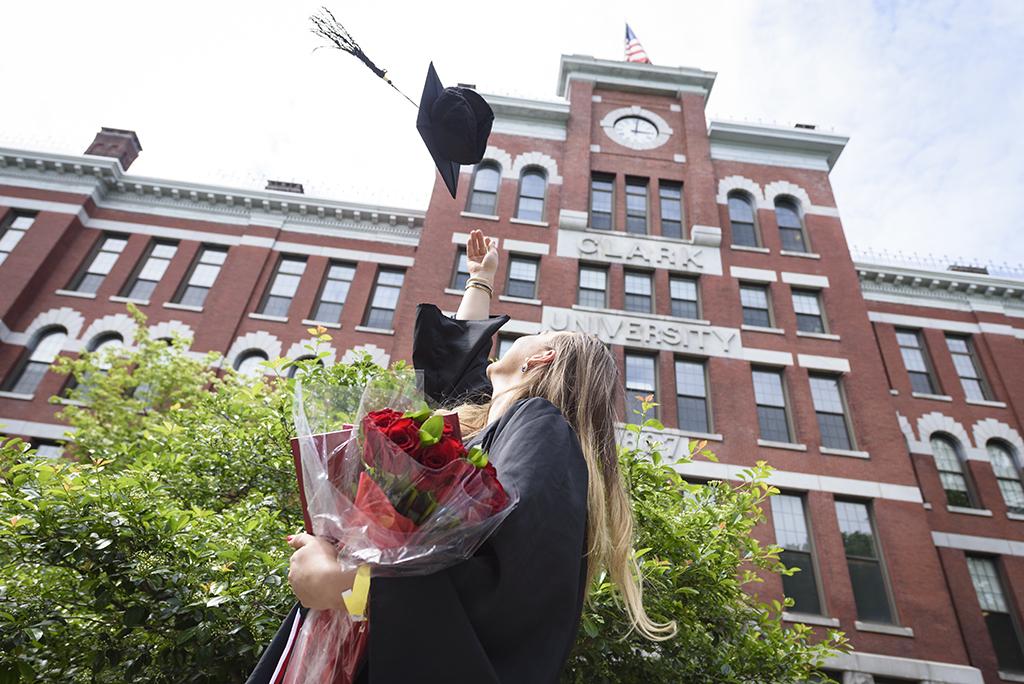 Graduate tosses cap at Clark University commencement