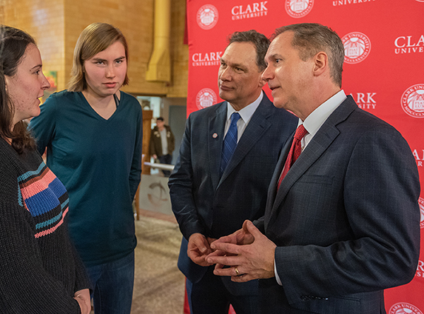 David Fithian (right) and Michael Rodriguez greet students after the January 13, 2020 program when Fithian was announced as Clark's new president.