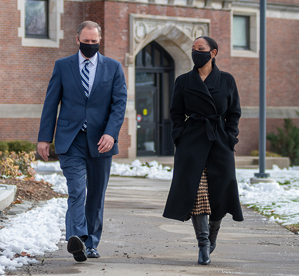 David Fithian walks on campus with Esther Jones, dean of the faculty