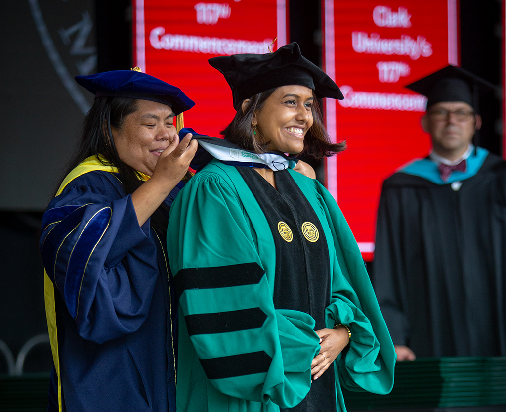 Student receives doctoral hood during graduate Commencement ceremony
