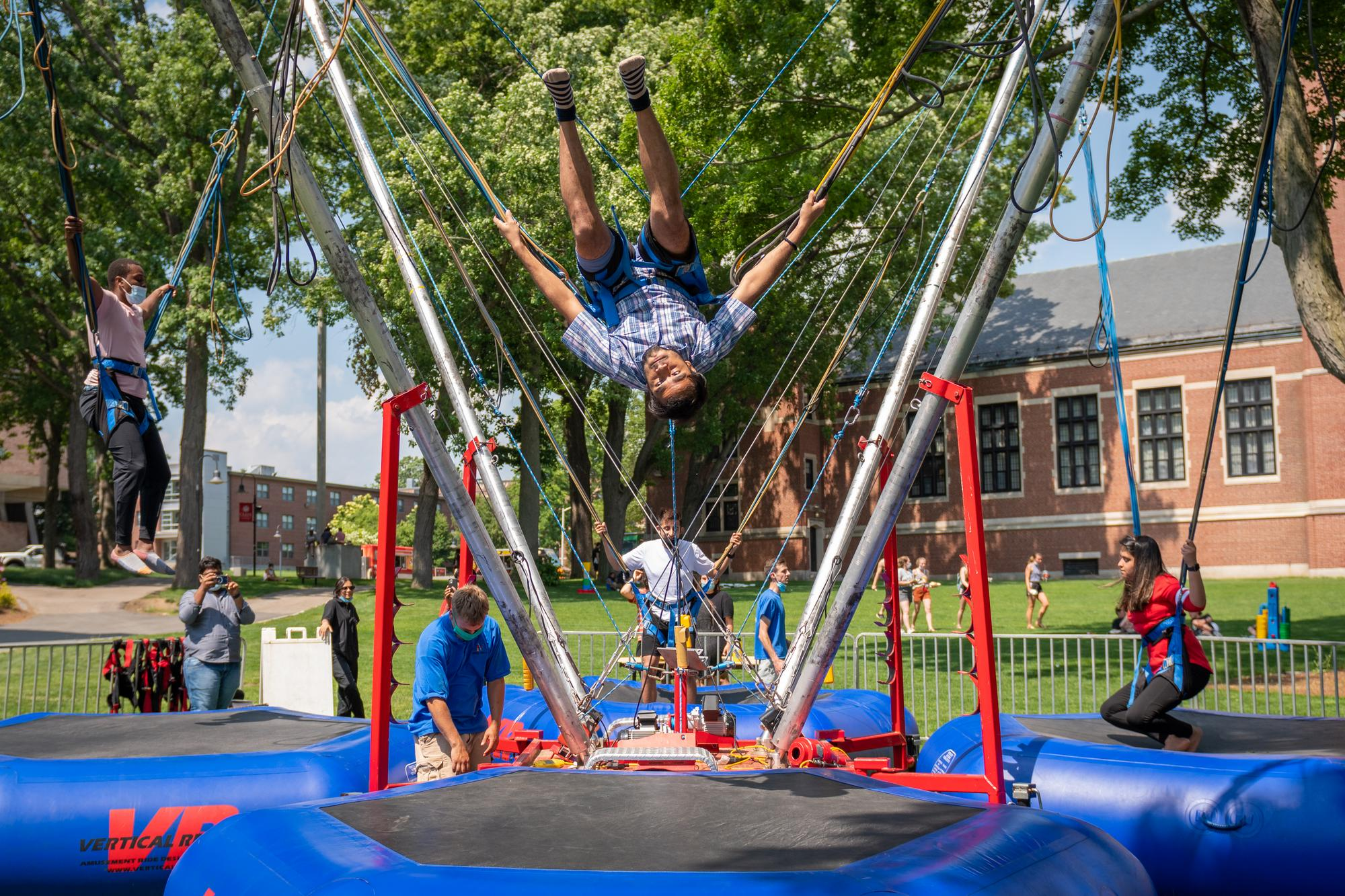 students jump on bungee trampolines