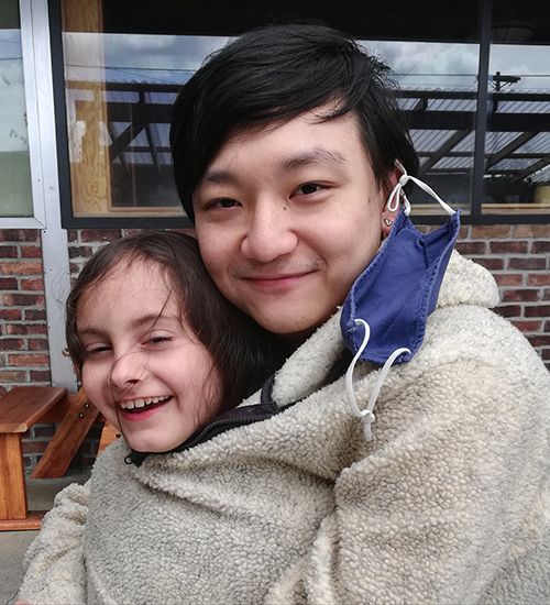 Calvin Choi '12 with his 8-year-old daughter, Shoshanna.