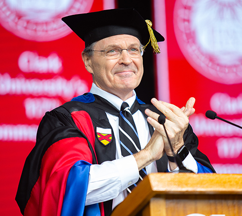 Davis Baird applauds at the graduate commencement ceremony