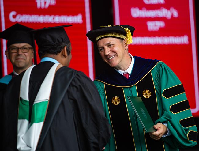 David Fithian congratulates a student