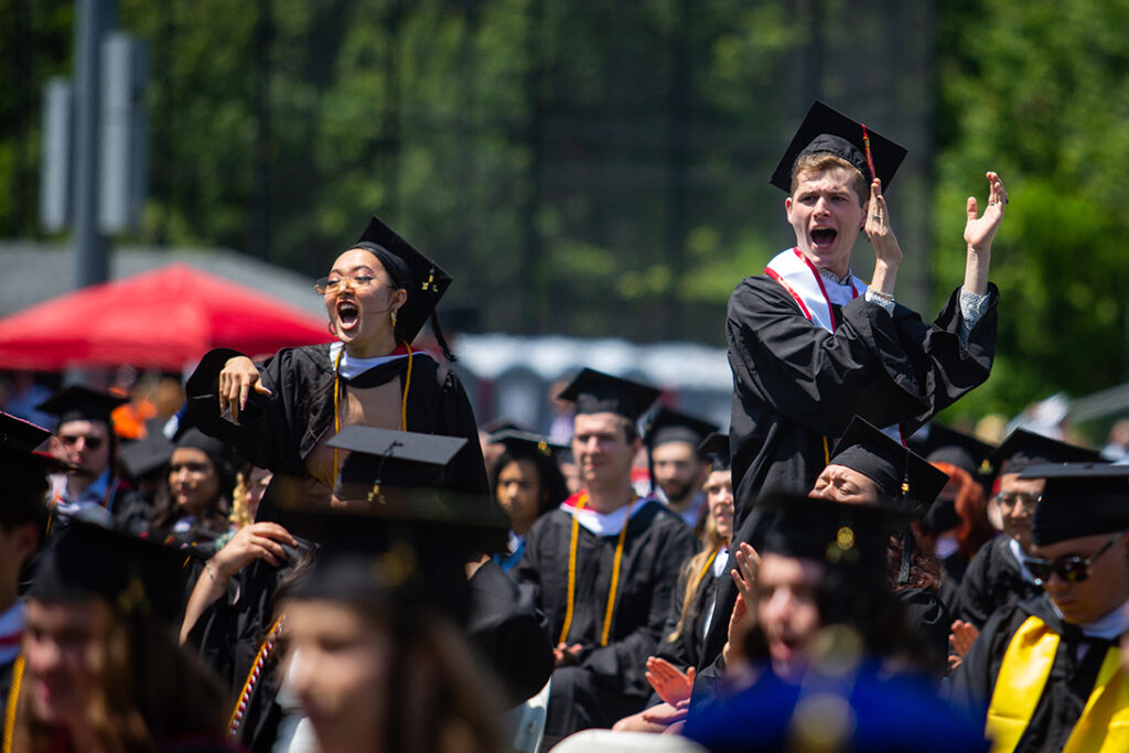Students cheering at Clark University Commencement