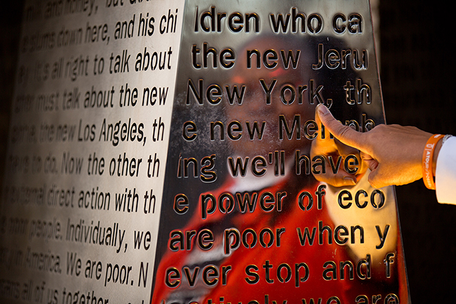 """Carolyn Michael-Banks' reflection in the """"I Am a Man"""" sculpture"""