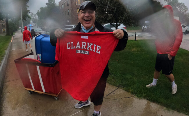 Family member of new Clark student proudly displays his Clarkie D shirt.