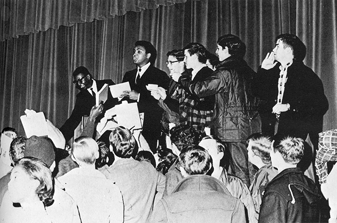 Muhammad Ali signs autographs at Atwood Hall in 1968